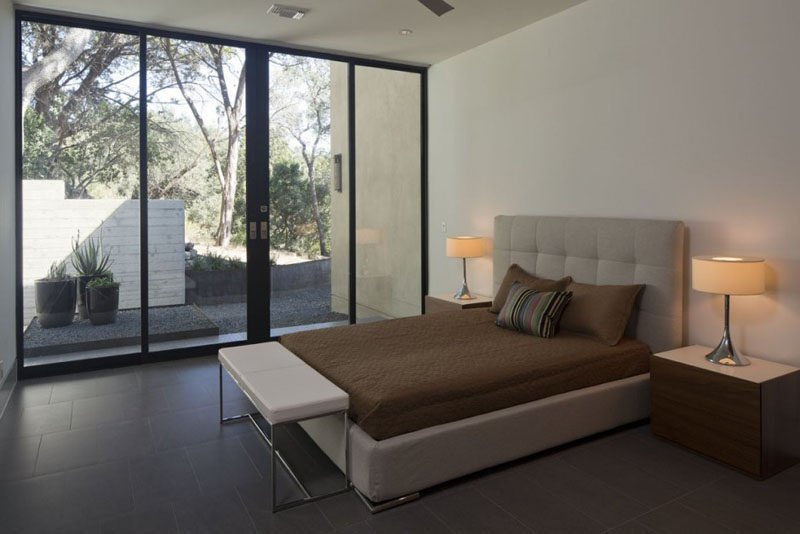 In this bedroom, large sliding glass doors can be opened to the garden outside.
