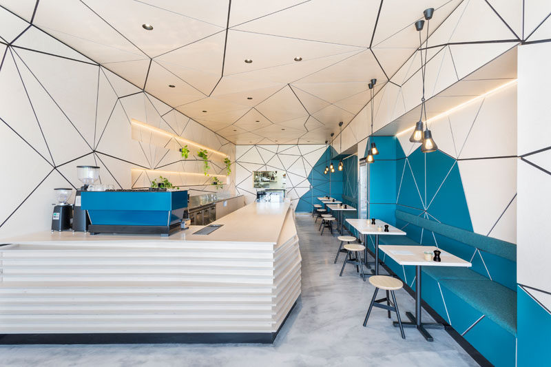 The Interior Of This Cafe Is Covered In Geometric Panel