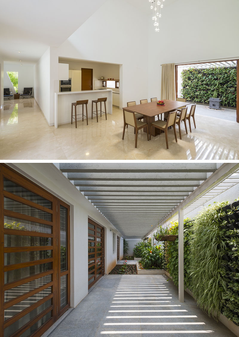Off to the side of this dining room is an outdoor area with a green wall and pergola to provide shade.