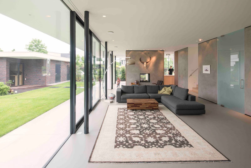 In this living room, the large glass doors slide open to create indoor/outdoor living spaces.