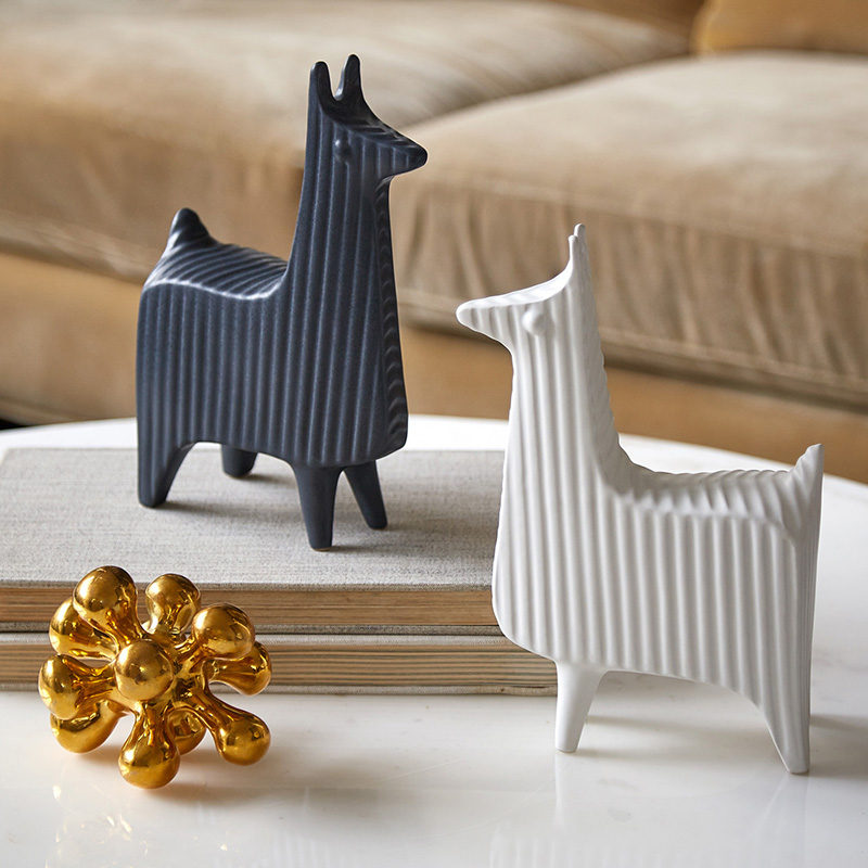 18 Decorative Animal Objects That Blur The Line Between Toys And Decor // Add a couple of llamas to your coffee table for a bit of sophisticated fun.