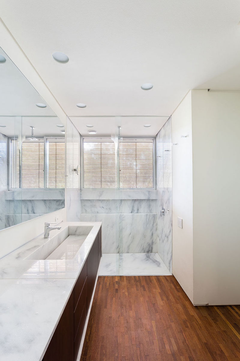 Bathroom Design Idea - Extra Large Sinks Or Trough Sinks (20 Pictures) // This marble trough sink matches both the countertops and the shower creating a sophisticated and unified look.