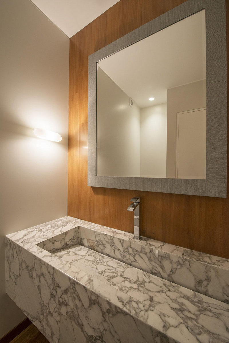 Bathroom Design Idea - Extra Large Sinks Or Trough Sinks (20 Pictures) // This marble trough sink features an invisible drain that allows for a seamless and stylish design.