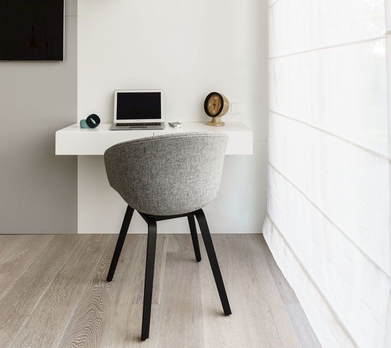 A small floating wall mounted desk creates a useful area out of a small space.