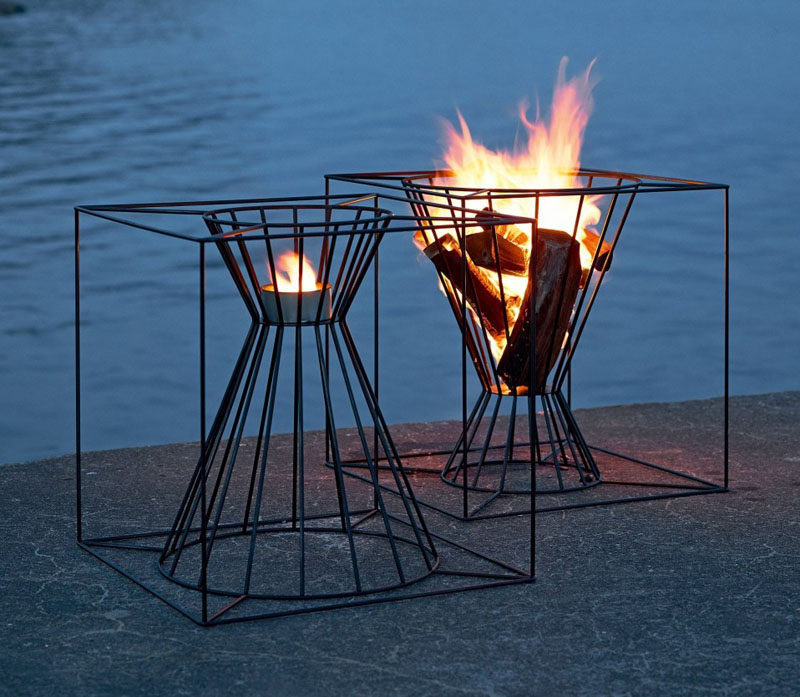Warm Up Your Life With These 13 Freestanding Fireplace Designs // These steel fire baskets allow you to use either end of them to create fires of different sizes.