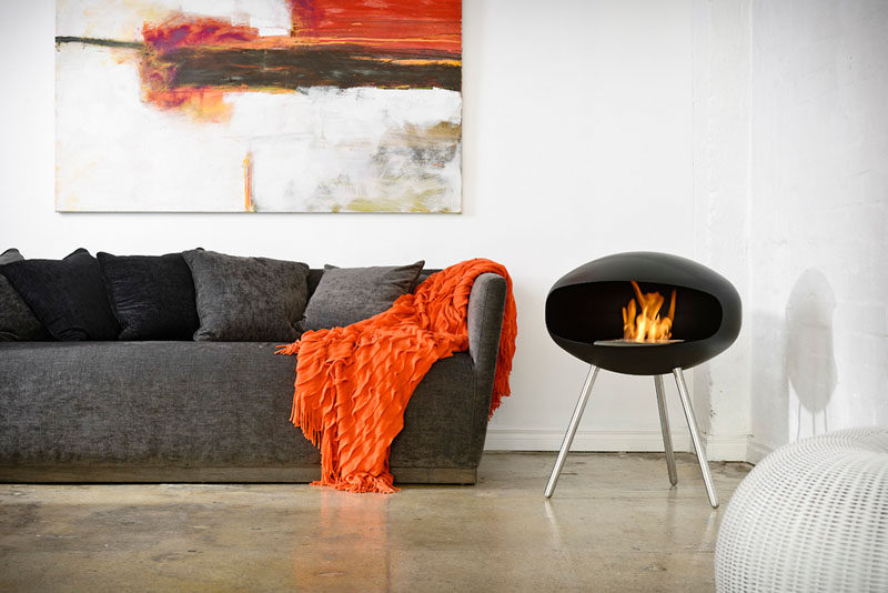 Warm Up Your Life With These 13 Freestanding Fireplace Designs // This simple and modern freestanding fireplace is the perfect size for heating a small room and burns cleanly so you can feel good about having it indoors.
