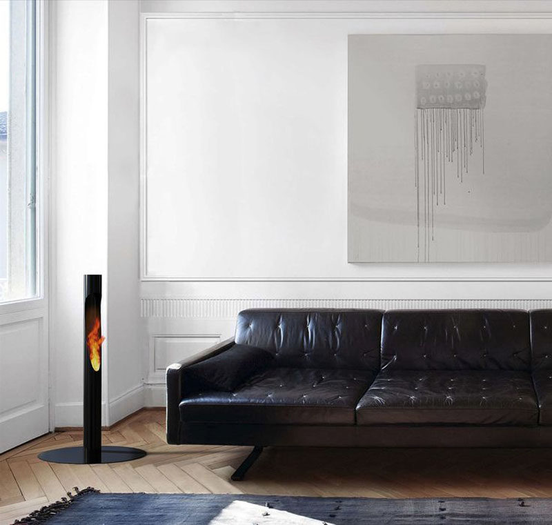 Warm Up Your Life With These 13 Freestanding Fireplace Designs // This sleek black freestanding fire column looks great both indoors and outdoors, and is light enough to move it easily between the two.