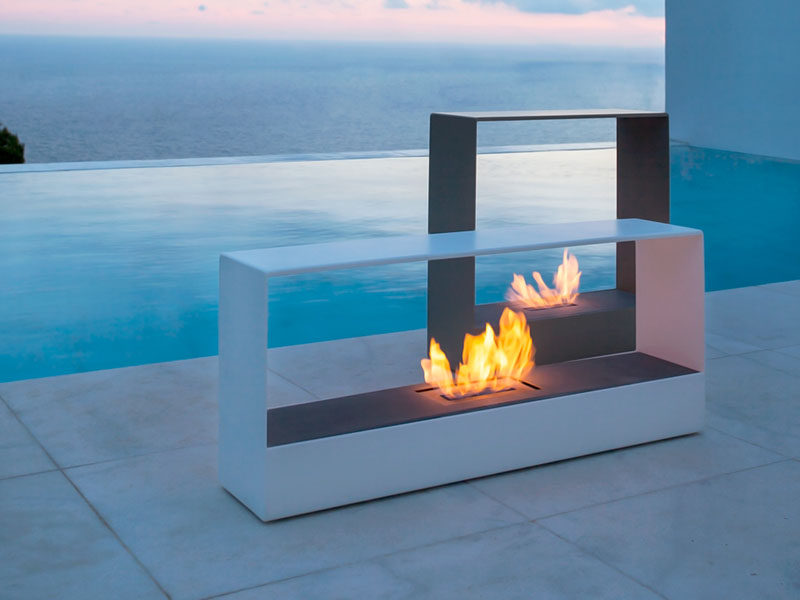 Warm Up Your Life With These 13 Freestanding Fireplace Designs // Sleek rectangular standalone fireplaces like these are the perfect addition to any outdoor set up and can be moved around to accommodate various arrangements.