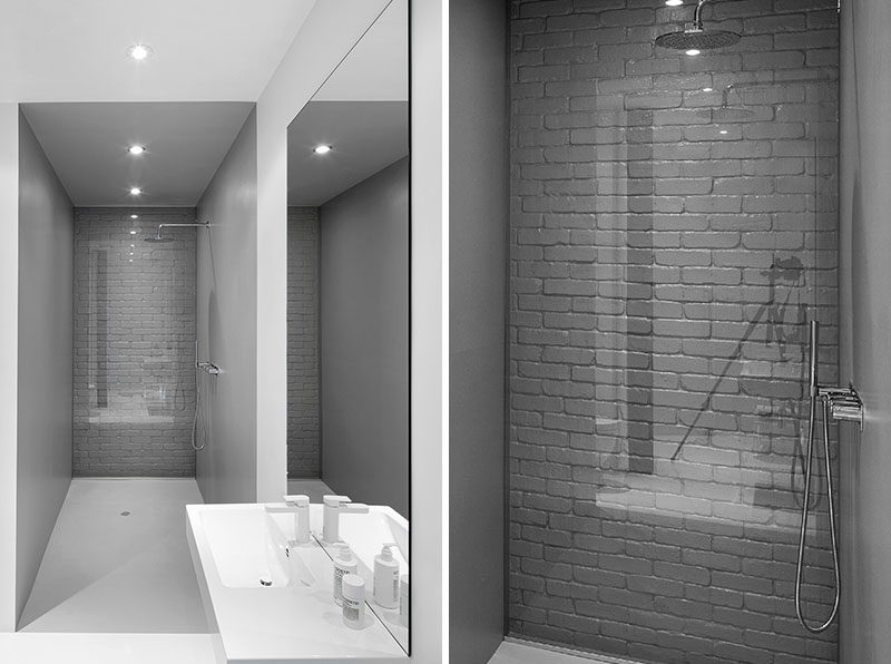 bathroom design idea use glass to cover an original brick wall and make it a feature. Black Bedroom Furniture Sets. Home Design Ideas