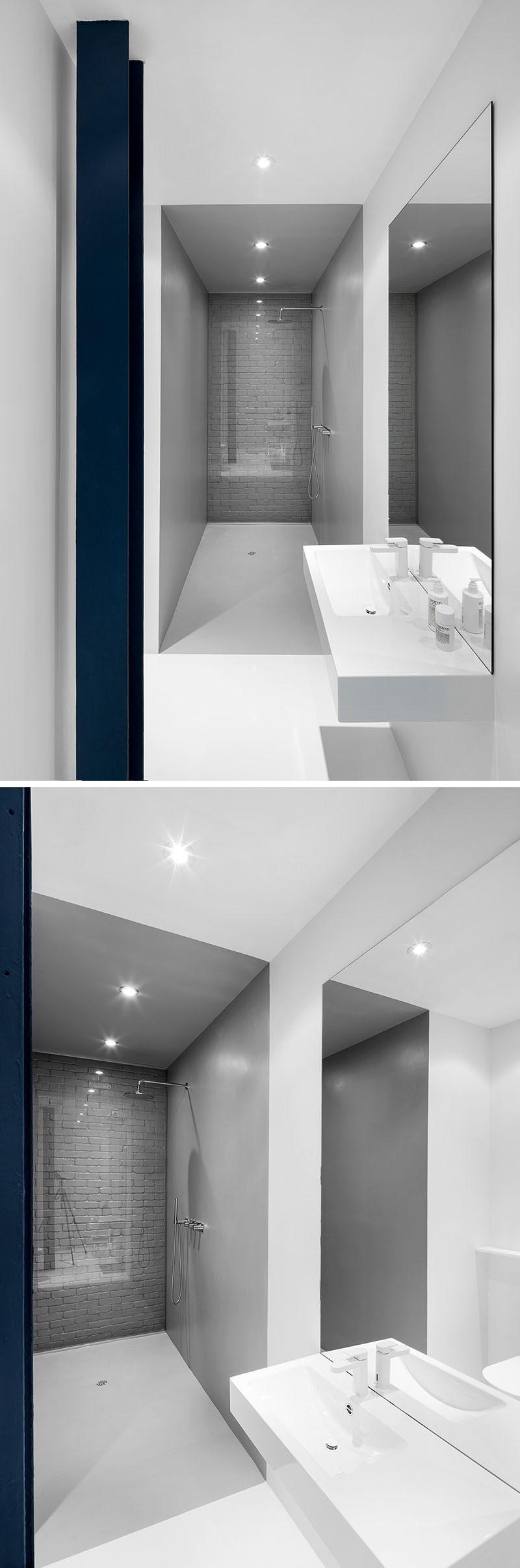 Bathroom Design Idea - Use Glass To Cover An Original Brick Wall In The Bathroom So You Can Still Enjoy It