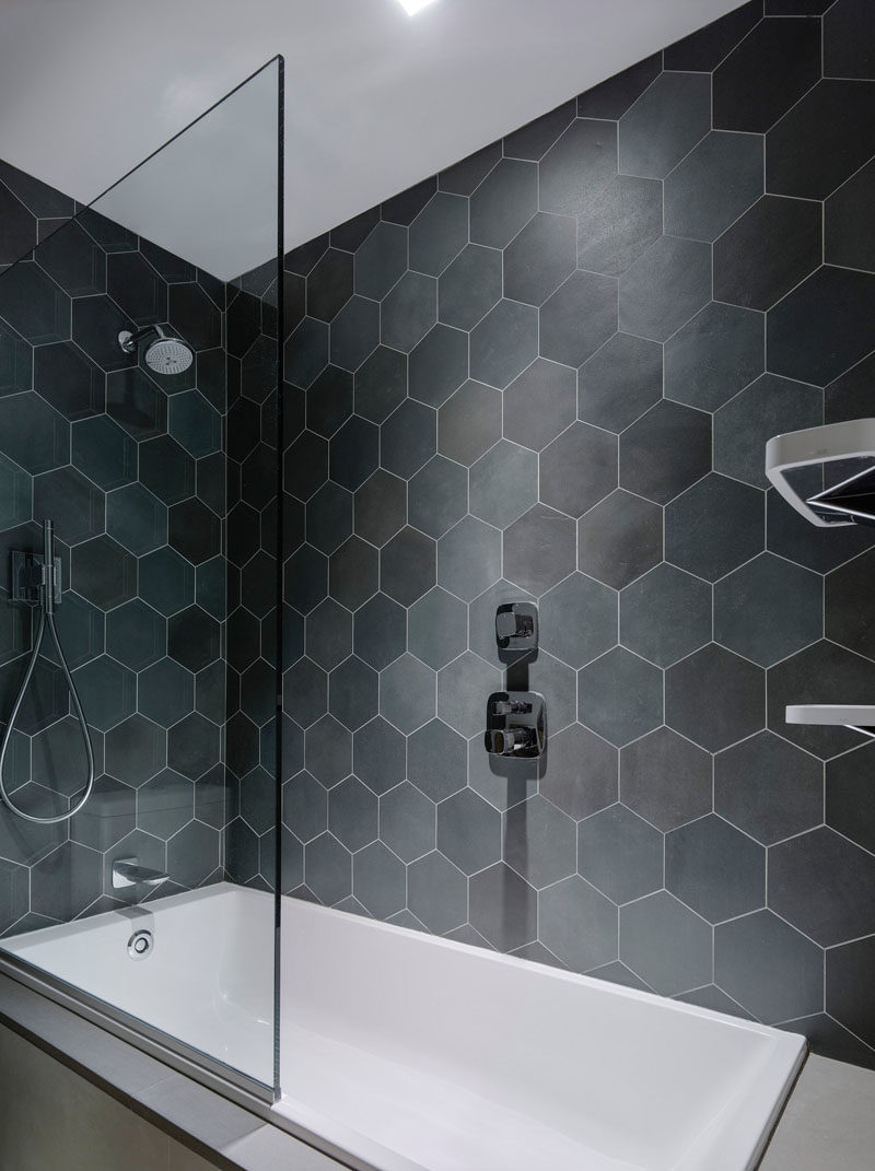 Hexagon Tiles In Various Shades Of Grey Line The Walls 2 1 Bath And Shower This Bathroom