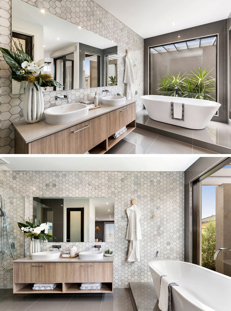 Bathroom Tile Ideas - Grey Hexagon Tiles // Grey and white marble hexagon tiles on the wall of this bathroom give the space a sophisticated and spa-like feel.