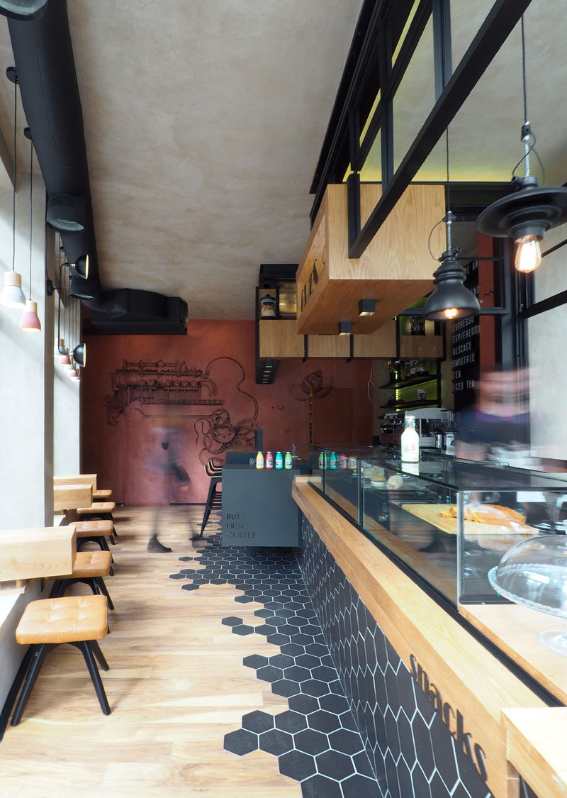 This Modern Coffee Shop Has Black Hexagon Tiles That Wrap Around From The Counter Down To