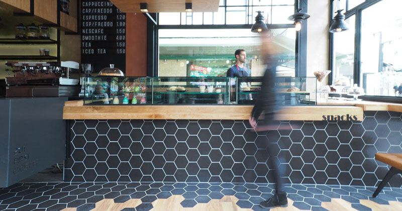 Hexagon Tiles Transition Into Wood Flooring Inside This Cafe Greece