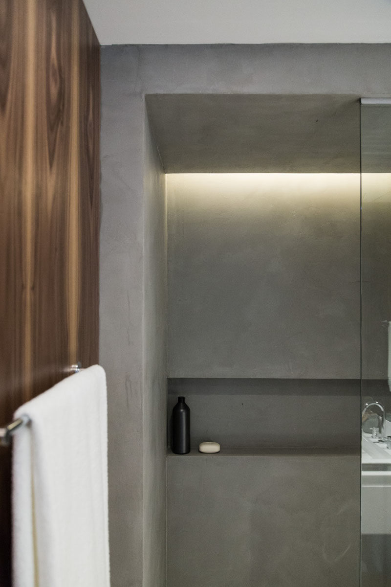 In this shower, a built-in shelf has been included in the design and hidden light provides a soft glow.