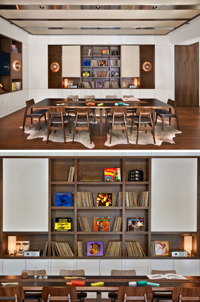 In the game room at the Arlo Hudson Square hotel, guests can gather and socialize with others. Built-in shelving inspired by 1960's speaker cabinets, are home to vinyl records and a turntable with headphones, games and puzzles.