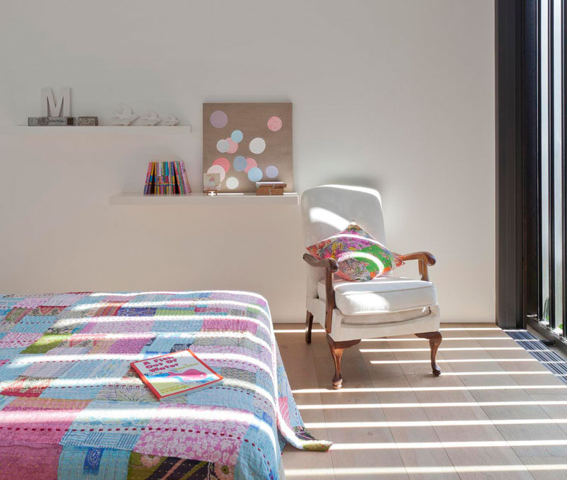 In the kids rooms, soft colors and light wood floors brighten up the room and add a touch of whimsy,