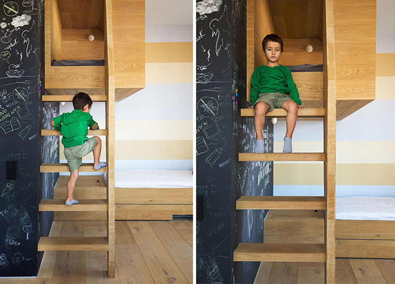 To reach this kids cubby, there's a ladder to climb that runs along side a chalkboard wall.