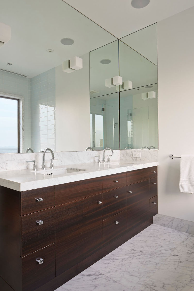 Fresh Bathroom Mirror Ideas Fill The Wall The large mirror in this bathroom wraps