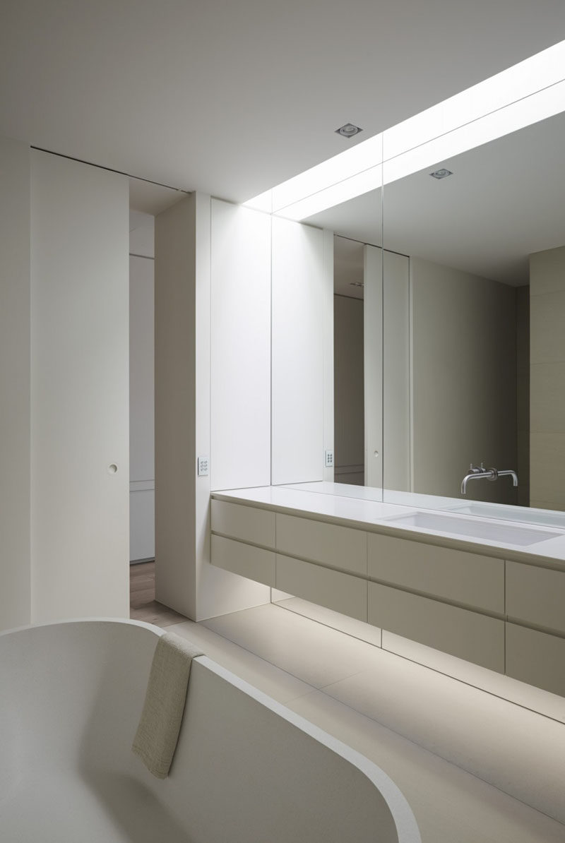 Trend Bathroom Mirror Ideas Fill The Wall The mirror in this bathroom reaches the