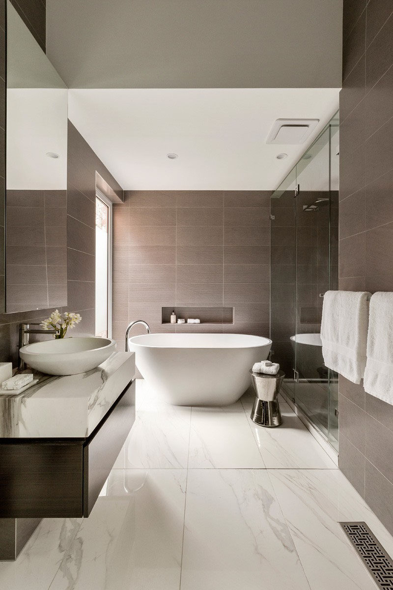 The Large Tiles Featured On Walls Of This Bathroom Bring Out Darker Flecks Found In Used For Floors