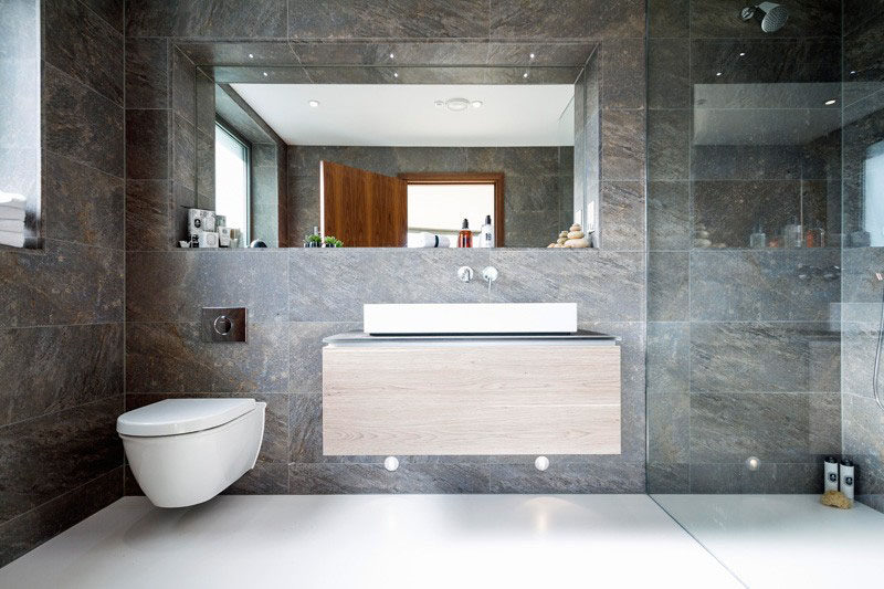 These large wall tiles add texture to the bathroom and create just the  right amount of contrast with the super smooth white floor. Bathroom Tile Idea   Use Large Tiles On The Floor And Walls  18