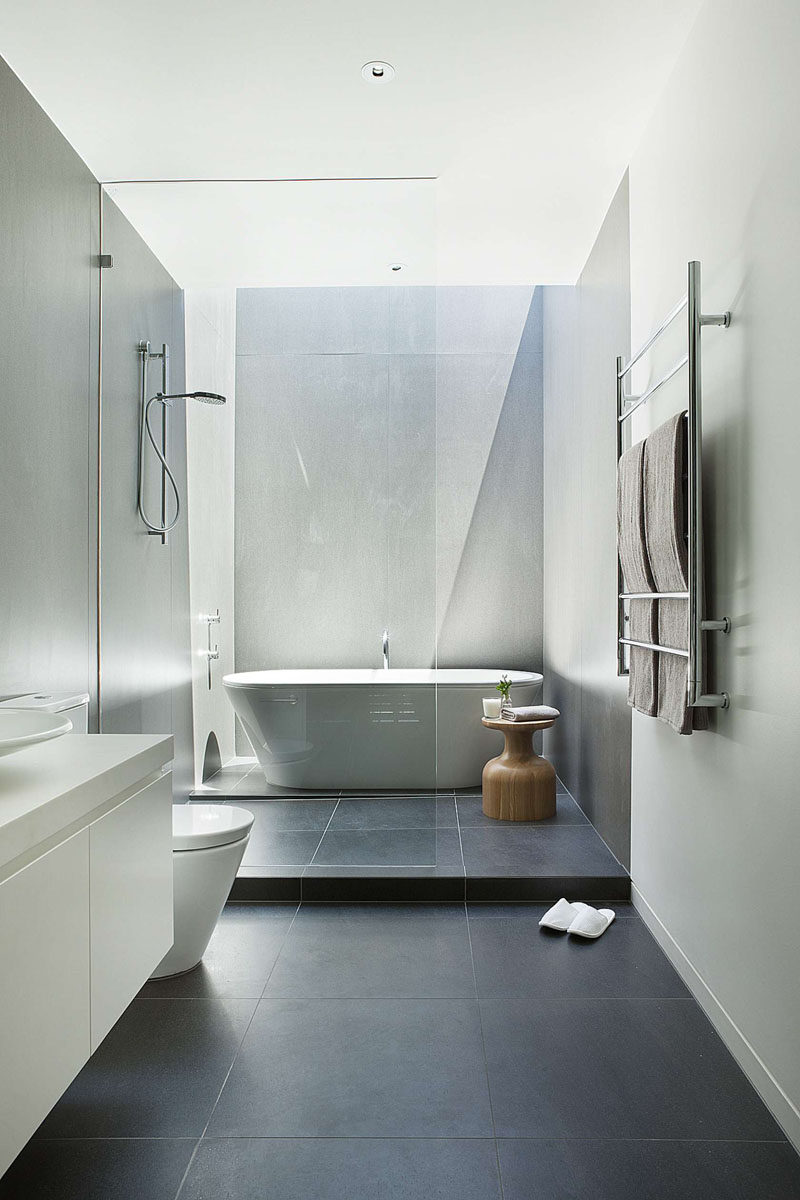 The Large Dark Floor Tiles Paired With Light Walls In This Bathroom Make  The Room Seem Larger And More Open.