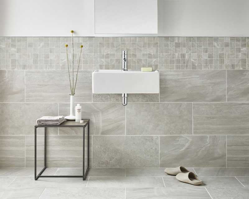 Large Tiles That Flow From The Floor To Wall Together With Smaller Line Bottom Half Of This Bathroom Help Create A