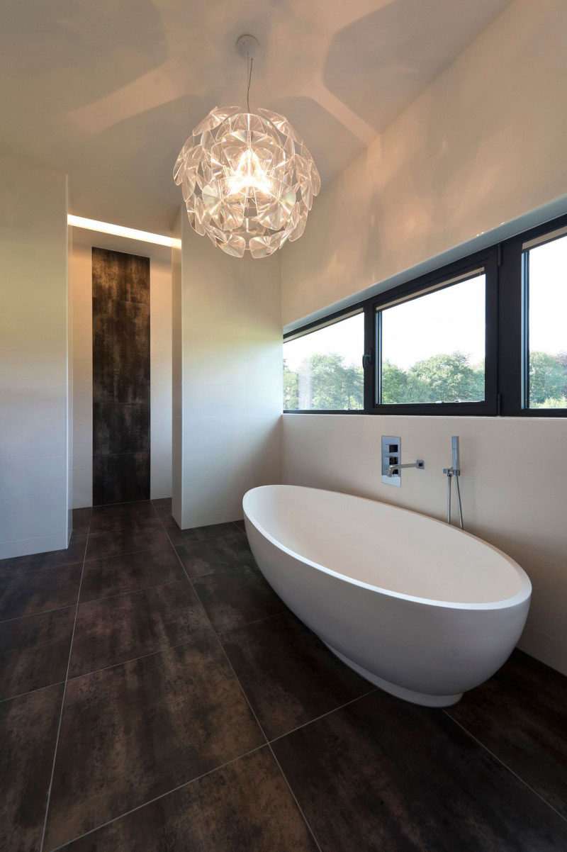 The Large Dark Tiles In This Bathroom Allow To Feel Extra Lavish And Continuation Of Tile Up Part Wall Just Outside