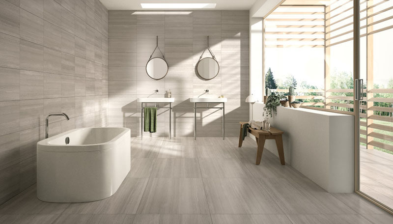 Large Light Colored Matching Tiles On The Floor And Walls Of This Bathroom Make E Feel Modern Bright