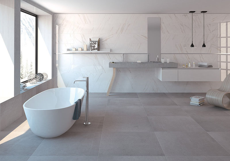 Bathroom Tile Ideas - Use Large Tiles On The Floor And Walls // The large floor tiles used in this large bathroom help keep the room feeling open and flowing rather than crowed and claustrophobic.