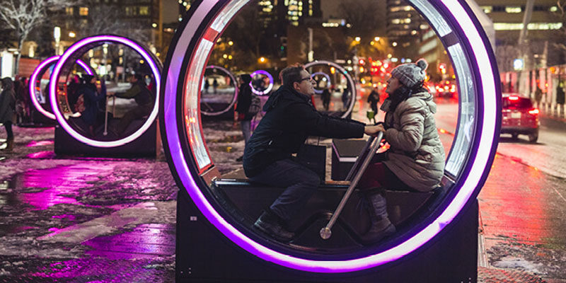 These illuminated cylinders display fairy tales when people get inside to power them