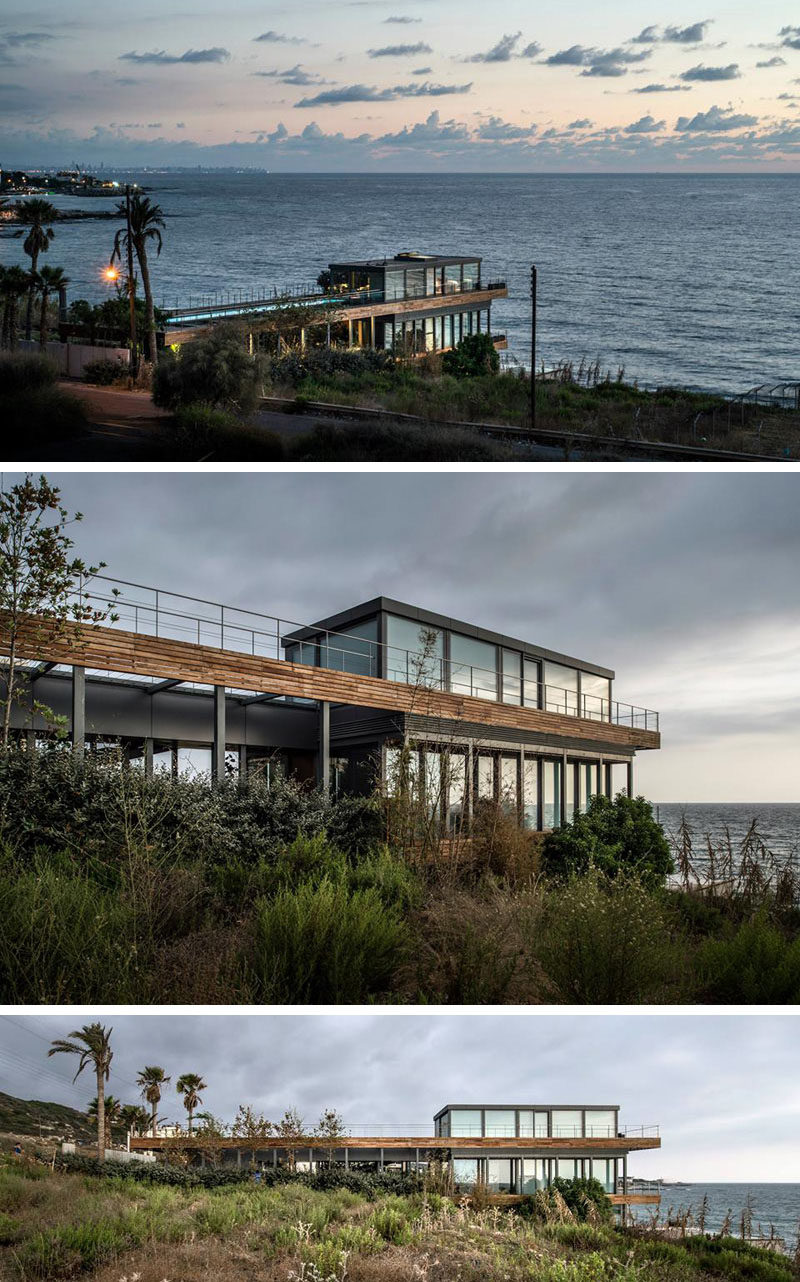 14 Examples Of Modern Beach Houses // Huge glass windows around this entire Lebanese beach house provide uninterrupted views of the Mediterranean ocean in front of it.