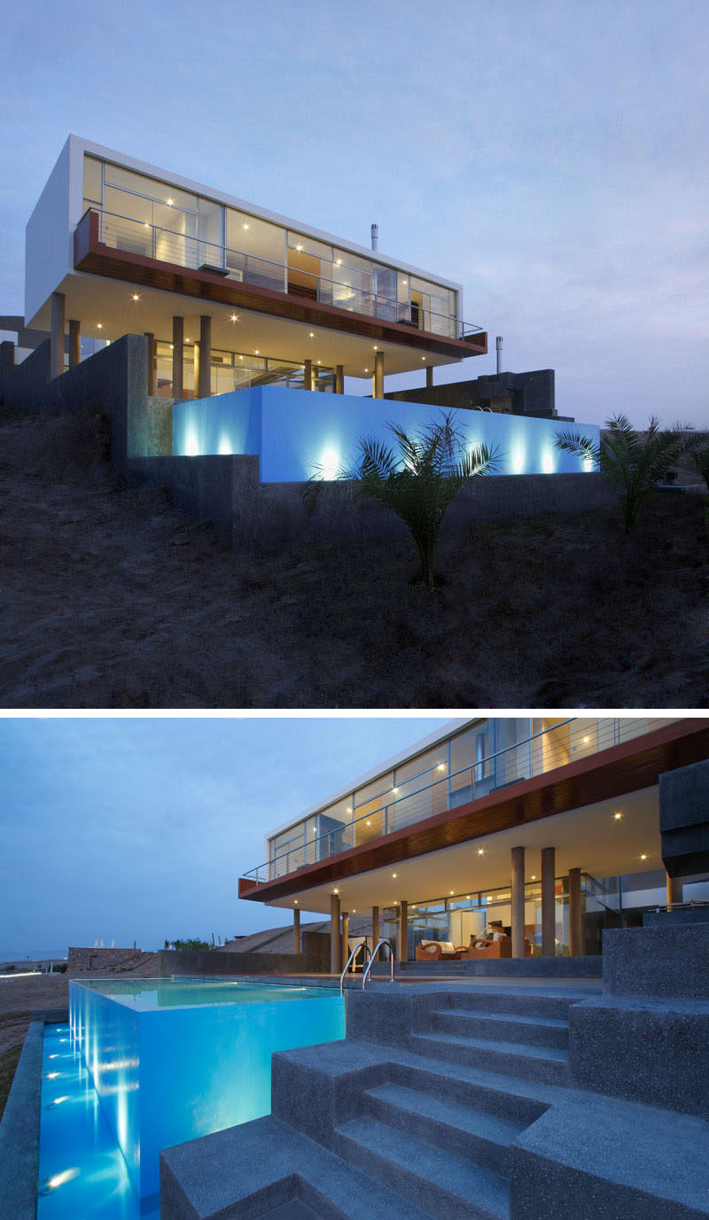 14 Examples Of Modern Beach Houses // The pool at the front of this contemporary beach house in Peru is contained in a cube that overlooks the Misterio Beach and out to the sea beyond.
