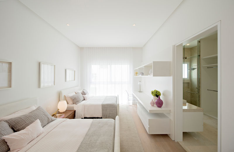 In this bedroom, soft grays and white walls create a calming atmosphere.