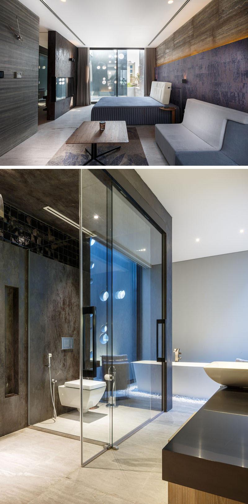This dramatic bedroom has an ensuite bathroom with walk-in shower. #ModernBedroom #EnsuiteBathroom #ModernBathroom