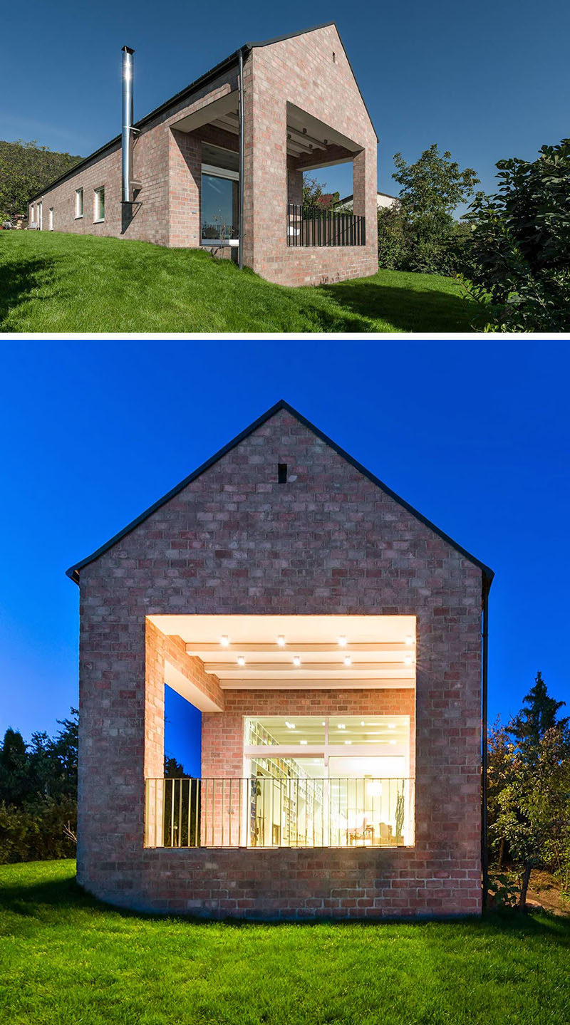 14 Modern Houses Made Of Brick // The brick covering this house give it a traditional look while the gabled roof keeps the design looking minimal and modern.