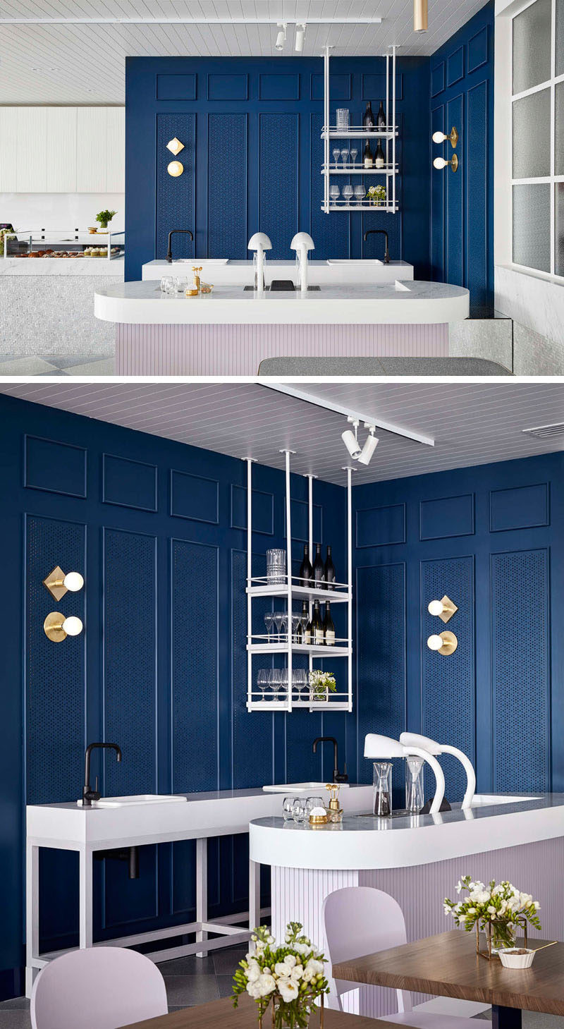Throughout this cafe, perforated timber mouldings create visual interest, while clean lines and soft lighting create a relaxed atmosphere, and royal blue ties the entire space together.