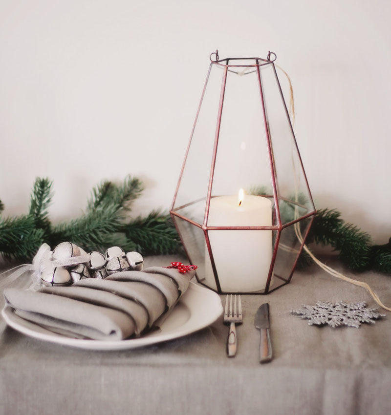 15 Inspirational Ideas For Creating A Modern Christmas Table Full Of Natural Elements //A few small lanterns or a couple of larger ones placed down the middle of your table make a beautiful centerpiece and create moody lighting perfect for a Christmas dinner.