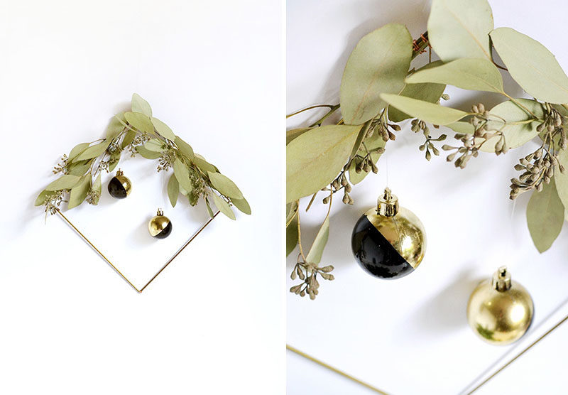 21 Modern Wreaths To Decorate Your Home With This Holiday Season // Rather than stick with the traditional round wreath, go for something a little more modern with this square one embellished with a bit of greenery and a couple of modern baubles.