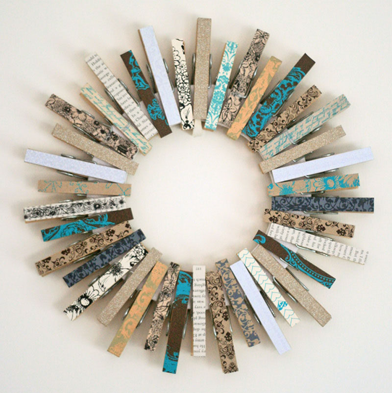 21 Modern Wreaths To Decorate Your Home With This Holiday Season // Decorate a circle with colorful clothes pins to create a simple, festive piece of decor.