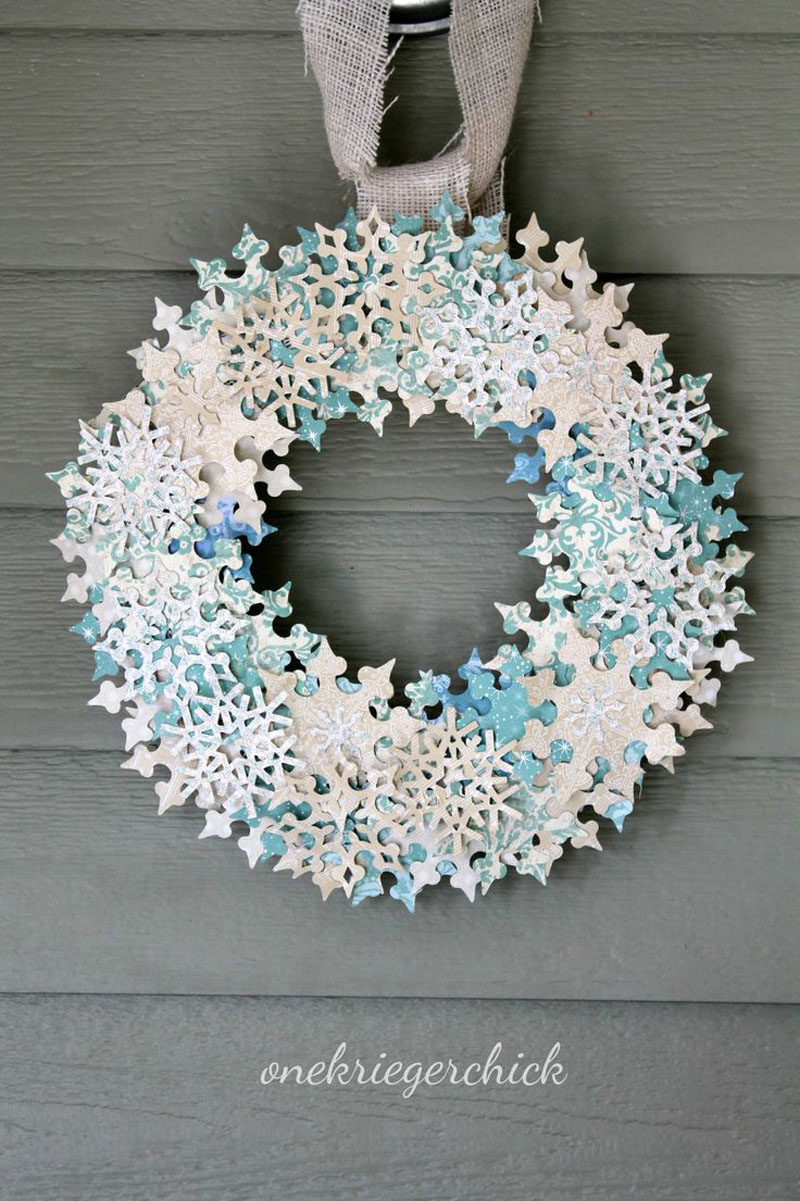 21 Modern Wreaths To Decorate Your Home With This Holiday Season // Sparkly snowflakes add just the right amount of glitter to this winter holiday wreath.