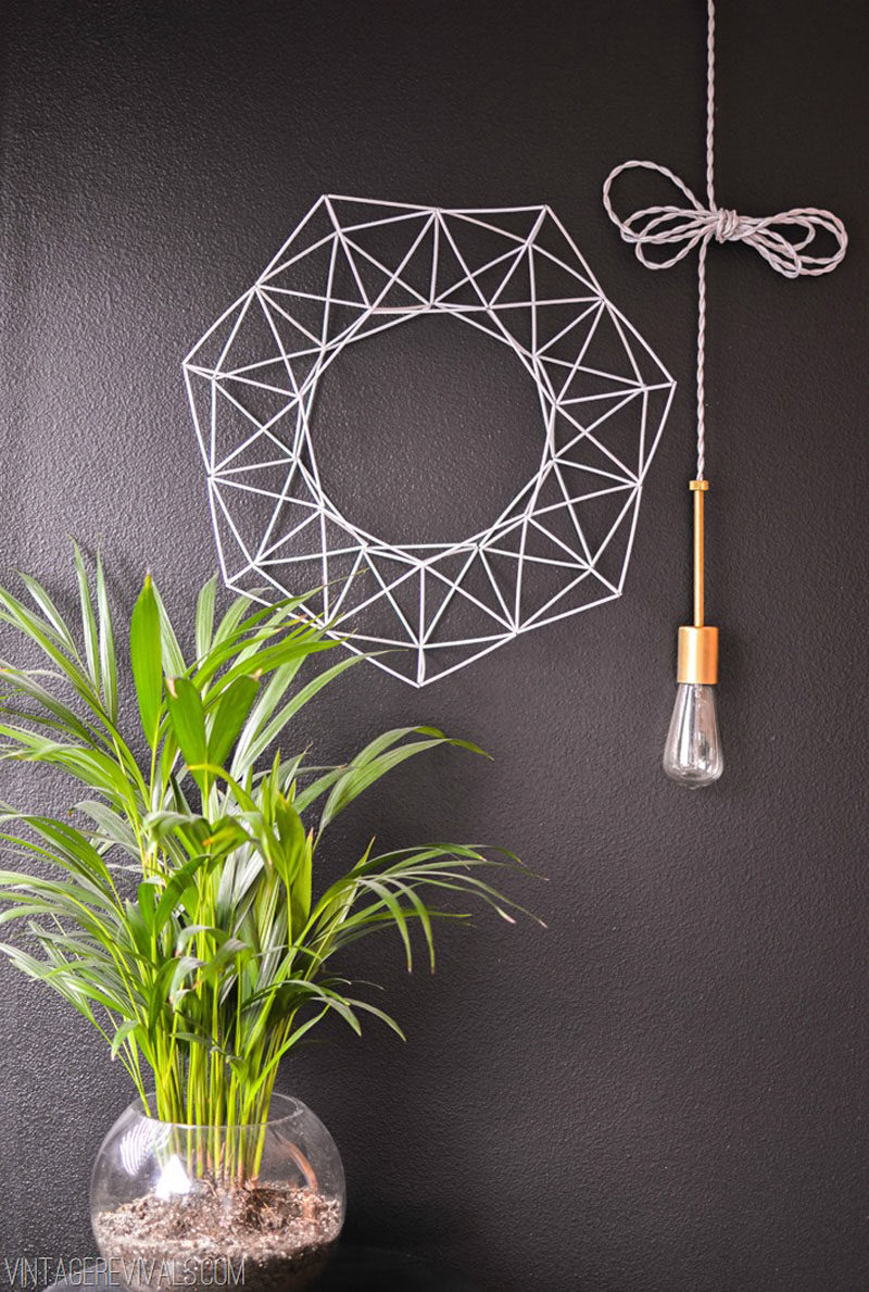 21 Modern Wreaths To Decorate Your Home With This Holiday Season // Create your own himmeli inspired wreath with just a few simple materials.