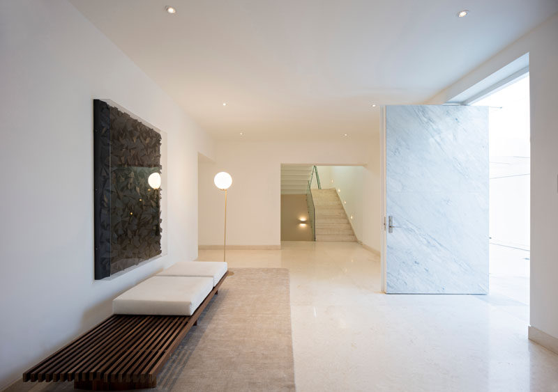 Inside this home, the entryway has been kept simple with an art piece and a bench.