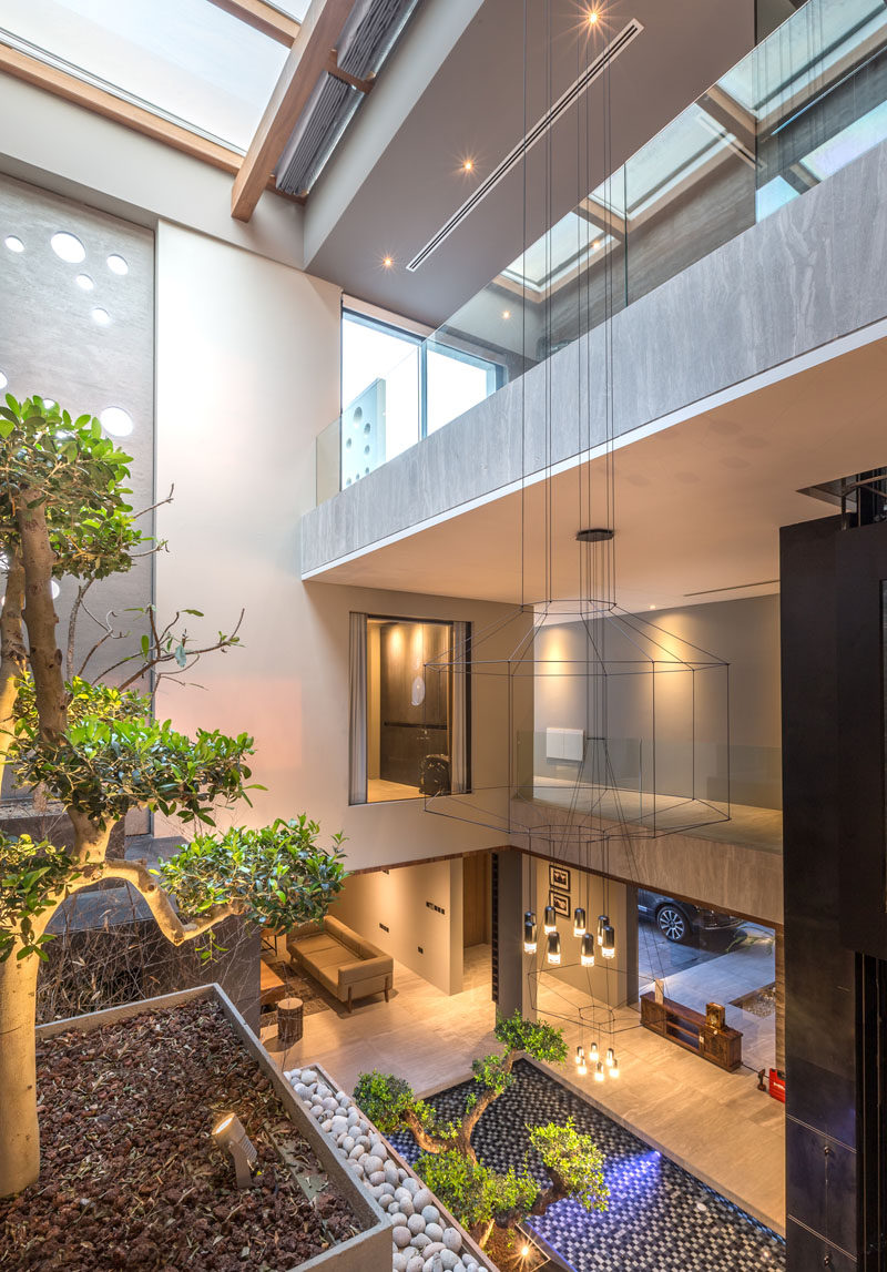 From the lounge area of the master suite in this modern house you are able to see the courtyard below and the skylight above. #Architecture #Courtyard