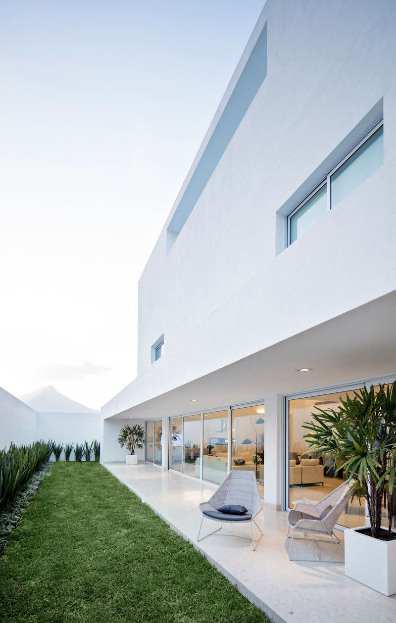 Just off the living areas of this home is a linear backyard that runs the length of the house. A covered patio area provides space to relax in the shade.