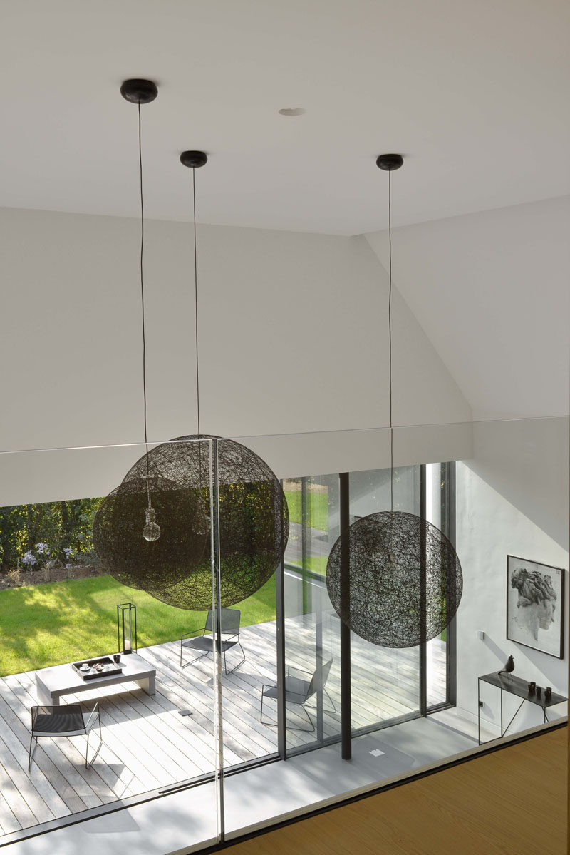 From the upper floor of this home, you are able to look down upon the living area below.