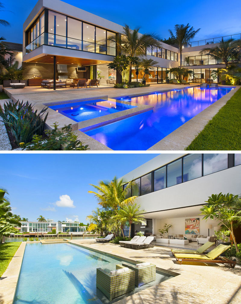 14 Examples Of Modern Beach Houses // A large swimming pool and plenty of palm trees give this Miami beach house a tropical feel that can be enjoyed even when it's a less than perfect day.