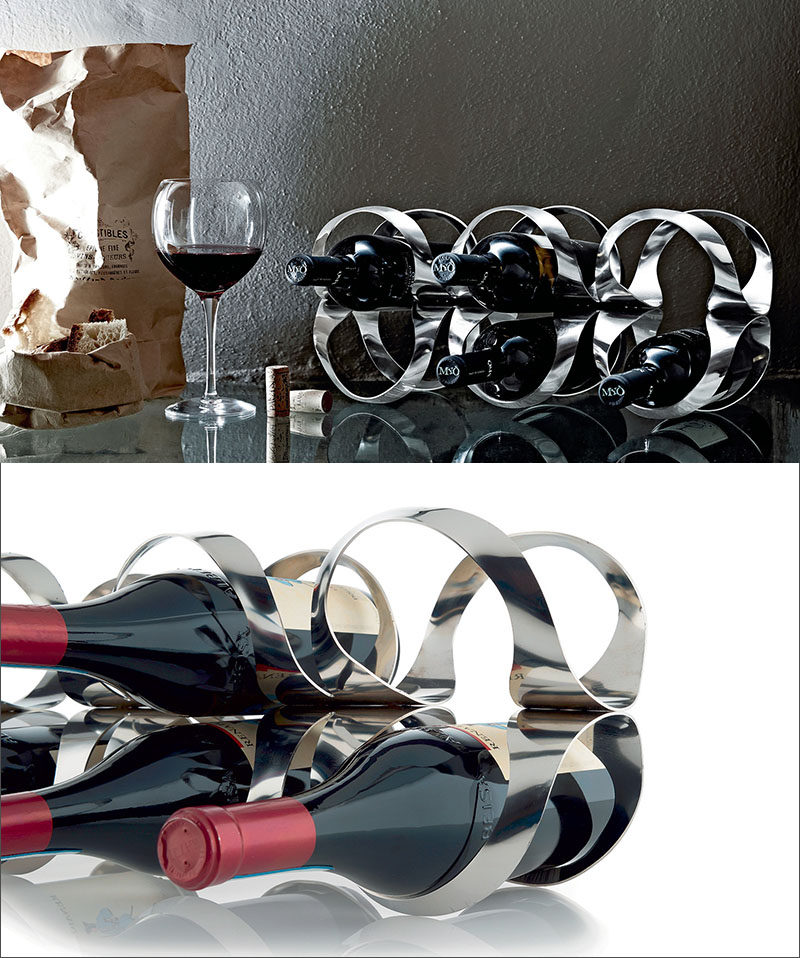 13 Wine Bottle Storage Ideas For Your Stylish Home // This sculptural wine rack makes your wine bottles part of a unique visual display that can sit right on your kitchen counter.
