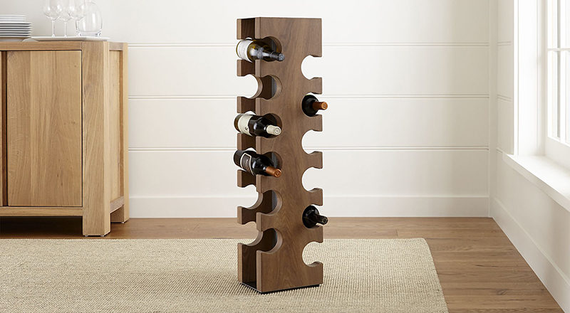 13 Wine Bottle Storage Ideas For Your Stylish Home // This standing wood wine rack holds 12 bottles of wine comfortably and keeps them off both the counters and the walls.